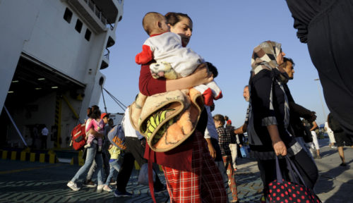 Syrian refugees and migrants disembark the Eleftherios Venizelos passenger ship at the port of Piraeus, near Athens, Greece, September 14, 2015. Of the record total of 432,761 refugees and migrants making the perilous journey across the Mediterranean to Europe so far this year, an estimated 309,000 people had arrived by sea in Greece, the International Organization for Migration (IMO) said on Friday. About half of those crossing the Mediterranean are Syrians fleeing civil war, according to the United Nations refugee agency. REUTERS/Michalis Karagiannis