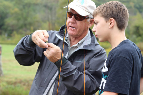 Gabriel Wooldridge, a resident of Boys Home, getting a pointer from Dusty Sprague, fly-fishing instructor. Photo: Sarah Jones.
