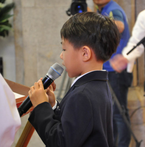 Christopher Chan-Young Kim, a descendant of the Rev. Mark Hee-Jun Kim, the Anglican Church in Korea's first Korean priest, reads the first lesson during the province's 125th anniversary celebration Eucharist Oct. 3 at the Cathedral of St. Mary and St. Nicholas in downtown Seoul. Photo: Mary Frances Schjonberg/Episcopal News Service