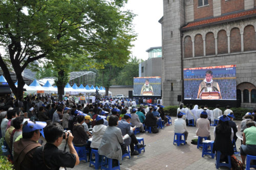 An overflow crowd listens to Seoul Archbishop Paul Keun Sang Kim, who is also the primate of the Anglican Church in Korea, preach Oct. 3 during the province's 125th anniversary celebration Eucharist Oct. 3 at the Cathedral of St. Mary and St. Nicholas in downtown Seoul. Photo: Mary Frances Schjonberg/Episcopal News Service