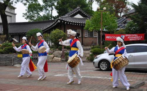 A traditional Korean pungmul group performs Oct. 1 outside the Anglican Cathedral of St. Mary and St. Nicholas in downtown Seoul before the opening Eucharist of Episcopal Asiamerica Ministries International Consultation. Photo: Mary Frances Schjonberg/Episcopal News Service