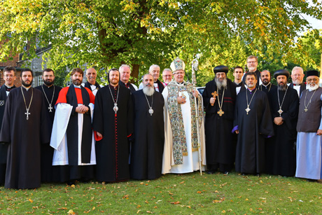 Members of the Anglican - Oriental Orthodox International Commission outside St. Asaph Cathedral, Wales. Photo: Nathaniel Ramanaden