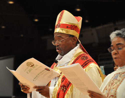 Presiding Bishop-elect Michael B. Curry sings during the Oct. 31 Vigil Celebration hosted by the Union of Black Episcopalians at the D.C. Armory on the eve of his installation as the 27th presiding bishop of The Episcopal Church and its primate. With him is the Rev. Christine L. McCloud, a deacon from the Diocese of Newark who served as his chaplain during the service. Photo: Mary Frances Schjonberg/Episcopal News Service