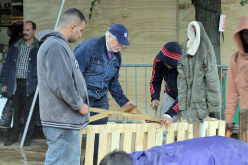 Bishop Pierre Whalon helps to volunteer with some construction work at the refugee camp in Brussels in September. Photo: Jere Skipper