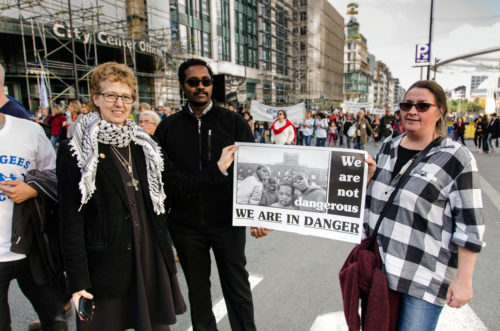 In Brussels, the Rev. Sunny Hallanan joins a Sept. 27 solidarity march to support refugees. Photo: Felicity Handford