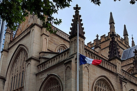 The French flag flies at half staff outside St Andrew's Cathedral, Sydney. Photo: Russell Powell