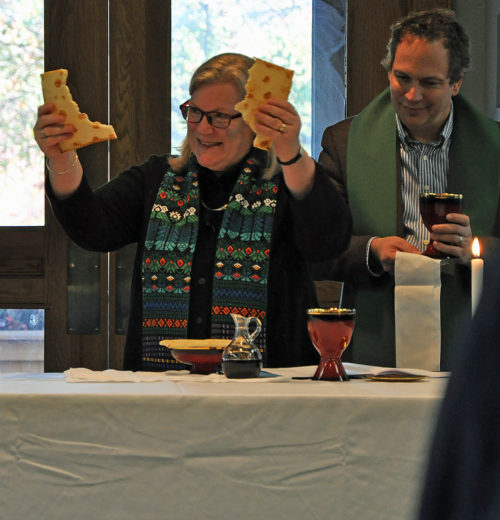 House of Deputies President the Rev. Gay Clark Jennings breaks the bread Nov. 15 during Eucharist at the opening session of The Episcopal Church Executive Council's Nov. 15-18 meeting at the Maritime Institute Conference Center in Linthicum Heights, Maryland. Photo: Mary Frances Schjonberg/Episcopal News Service