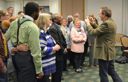 Members of Executive Council and staff of the Domestic and Foreign Missionary Society make a video greeting Nov. 16 for council member Diocese of Southwest Florida Bishop Dabney Smith who was absent from the meeting due to some health issues. The Rev. Frank Logue, council member from the Diocese of Georgia, served as videographer. Photo: Jim Simons/ via Facebook