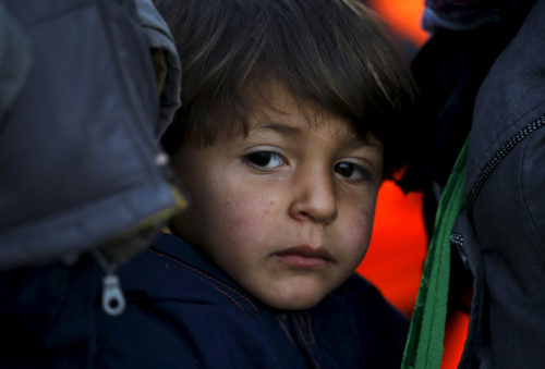 A Syrian refugee boy is seen shortly after arriving at a beach in a raft overcrowded with migrants and refugees in the Greek island of Lesbos, November 20, 2015. Balkan countries have begun filtering the flow of migrants to Europe, granting passage to those fleeing conflict in the Middle East and Afghanistan but turning back others from Africa and Asia, the United Nations and Reuters witnesses said on Thursday. REUTERS/Yannis Behrakis