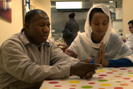 Refugees in a support centre pray the Lord's Prayer in a scene from the Just Pray cinema advertisement. Photo/Anglican Communion News Service