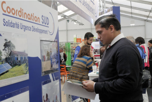 The Rev. Deacon Brandon Mauai of the Diocese of North Dakota explores the exhibit space in the green zone at COP21. Photo: Lynette Wilson/ENS