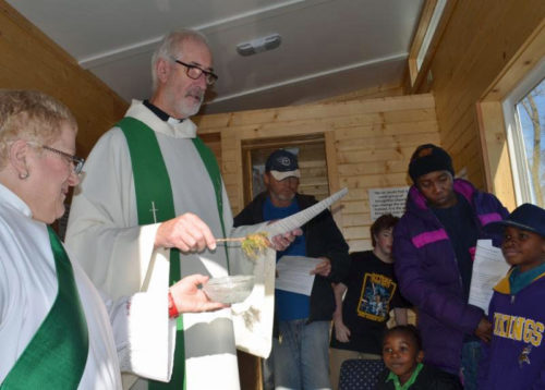 The Rev. Fred Nairn and The Rev. Priscilla Gray lead a blessing of the Tiny House. Photo: Episcopal Church in Minnesota