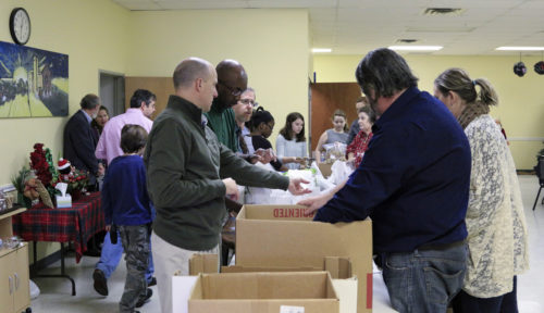 Members of St. Martin-in-the-Fields Episcopal Church in Keller, Texas, make sack lunches during the parish's Dec. 13 Service Sunday, a monthly intergenerational ministry, where sack lunches are made and delivered to the Union Gospel Mission of Tarrant County. Children as young as 18 months have assisted, along with folks in their 80s and many in between. Photo: St. Martin-in-the-Fields Episcopal Church