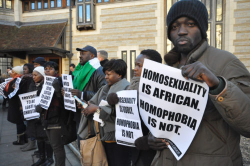 A group of some 40 gay and lesbian Africans gathers outside Canterbury Cathedral Jan. 15 to protest the actions of the Anglican Communion primates in calling for the exclusion of the Episcopal Church from Anglican dialogues and committees. Photo: Matthew Davies/Episcopal News Service