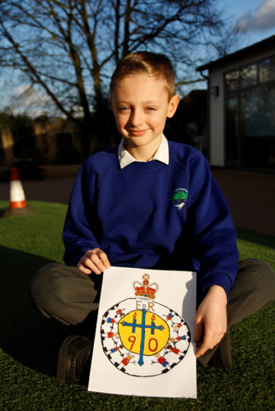Luke Sallinger with his winning design which will be used in the C of E's celebrations for Queen Elizabeth II's 90th Birthday Photo: Church of England