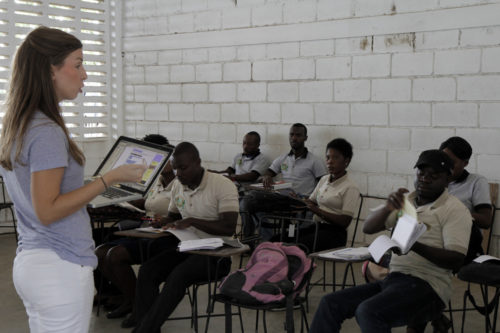 Eliza Brinkley, a Young Adult Service Corps missionary from the Diocese of North Carolina, teaches English to students at the St. Barnabas Center for Agriculture. In addition to studying agriculture and agriculture techniques, students study English, French, economics and other general education topics.