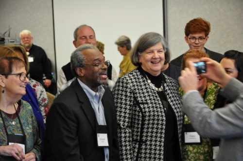 Before reconvening after lunch on Feb. 28, Executive Council members record a video birthday greeting for council member the Rev. Frank Logue's wife, Victoria. Photo: Mary Frances Schjonberg/Episcopal News Service