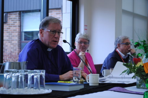 Archbishop Fred Hiltz says so much time and energy have been devoted to debate over human sexuality,  at the expense of other issues such as violence against women and climate change. With him at the CoGS meeting head table are Cynthia Haines-Turner, deputy prolocutor, and General Synod chancellor David Jones. Photo: André Forget