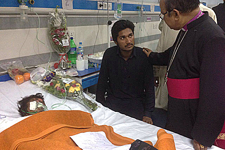The Moderator of the Church of Pakistan, Bishop Samuel Azariah visits victims of Easter Sunday's bomb blast in Lahore to support them and their families. Photo: Diocese of Raiwind