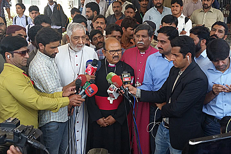 The Moderator of the Church of Pakistan, Bishop Samuel Azariah; the Bishop of Lahore, Irfan Jamil; and the former Bishop of Peshawar, Mano Rumalshah, speak to reporters after visiting victims of Easter Sunday's bomb blast and their families. Photo: Diocese of Raiwind