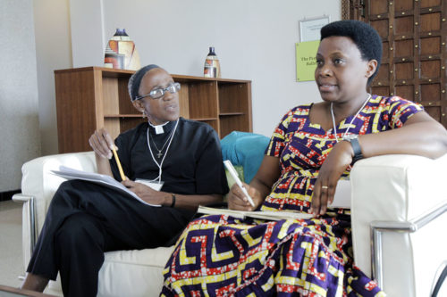 The Rev. Jenny Coley, left, an Episcopal Church-appointed missionary working on disease control and prevention in the Province of West Africa, and the Rev. Jeanne Ndimubakunzi, who heads the Province of Burundi's program on preventing gender-based violence participate in a small working group discussion on health and the environment. Photo: Lynette Wilson/Episcopal News Service