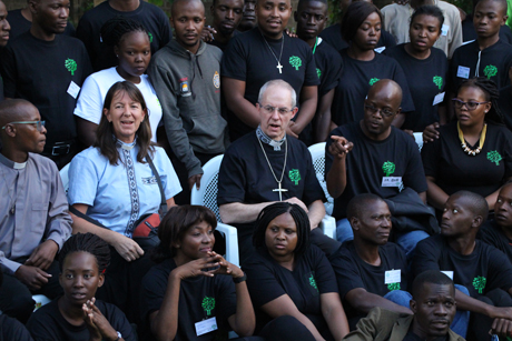 Archbishop of Canterbury Justin Welby with the Revd Dr Rachel Mash, environmental coordinator for the Anglican Church of Southern Africa with some of the youth participants at the environment and discipleship conference in Lusaka. Photo: Gavin Drake/Anglican Communion News Service