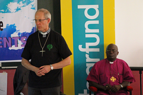 The Archbishop of Central Africa, Albert Chama, listens as Archbishop of Canterbury Justin Welby addresses young southern African Anglicans at an environmental and discipleship conference in Lusaka. Photo: Gavin Drake/Anglican Communion News Service