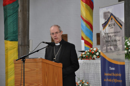 Archbishop of Canterbury Justin Welby April 8 reports to the Anglican Consultative Council about the January meeting of the communion's leaders – known as primates – during which those leaders called for consequences on the Episcopal Church for its decision to allow same-sex marriage. Photo: Mary Frances Schjonberg/Episcopal News Service