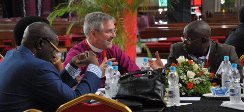 Connecticut Bishop Ian Douglas, Episcopal Church bishop member of the Anglican Consultative Council, speaks with his tablemates during a recent session of the ACC16 meeting in Lusaka, Zambia. Photo: Mary Frances Schjonberg/Episcopal News Service