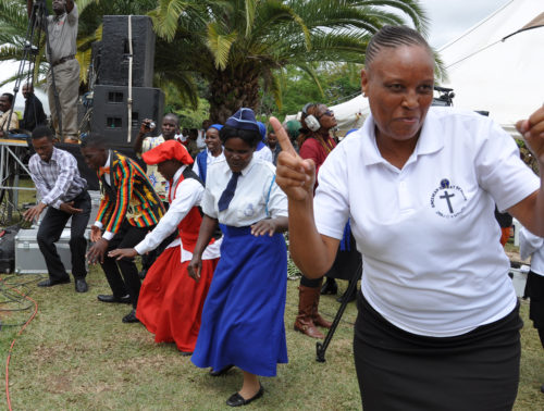 Passing the peace became an extended dance party. Photo: Mary Frances Schjonberg/Episcopal News Service