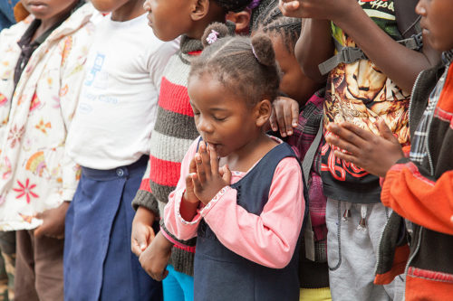 A young Anglican prays the Lord's Prayer before being dismissed for Sunday School. Photo: Anglican Communion Office