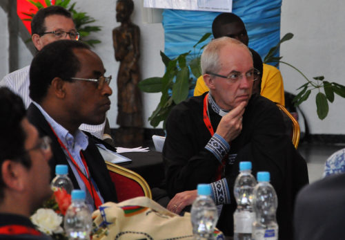 Archbishop of Canterbury Justin Welby listens to a presentation. Photo: Mary Frances Schjonberg/Episcopal News Service