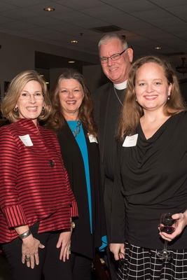Bishop Ed Konieczny and his wife, Debbie, with guests at the Iron Gate's Annual Founders' Dinner. Photo: Iron Gate