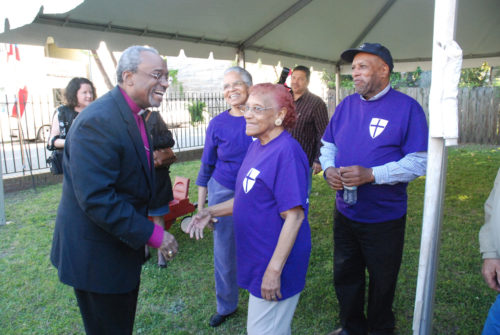 Presiding Bishop Michael Curry is greeted by members of historic Calvary Episcopal Church in Charleston at a neighborhood barbecue and block party on April 9 held to celebrate his three-day visit to The Episcopal Church in South Carolina. Photo: Holly Behre/the Episcopal Church in South Carolina