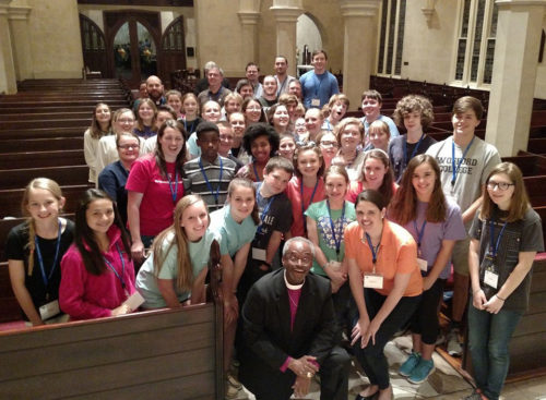 Presiding Bishop Michael Curry poses with some of the 50 youth who attended the Bishop's Lock-In on April 8 at Grace Church Cathedral in celebration of the Presiding Bishop's visit to Charleston April 8-10.