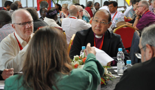 Archbishop Paul Kwong, center, the second and current archbishop and primate of Hong Kong Sheng Kung Hui was elected April 15 to chair the Anglican Consultative Council. Photo: Mary Frances Schjonberg/Episcopal News Service