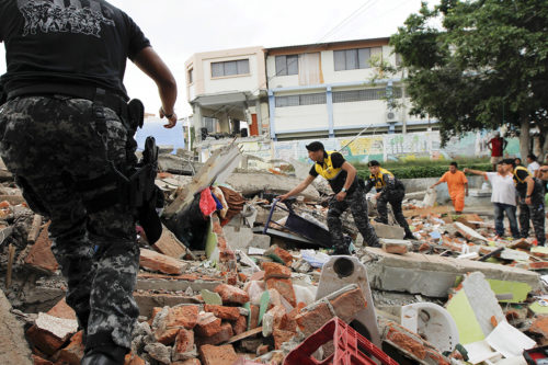 Red Cross members, military and police officers work at a collapsed area in the Tarqui neighborhood of Manta on April 17, 2016, after an earthquake struck off Ecuador's Pacific coast. Reuters/Guillermo Granja