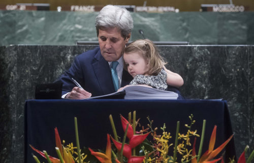 U.S. Secretary of State John Kerry, with granddaughter in tow, signs the Paris Agreement on April 22. Kerry was among 175 world leaders who signed the historic climate agreement in a ceremony coinciding with the 46th annual Earth Day. Photo: United Nations