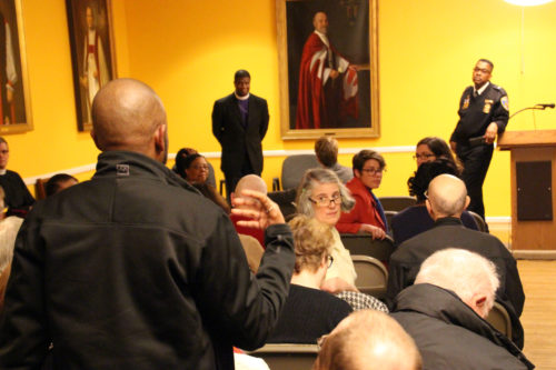 Merrick Moises questions Bishop Sutton and Lt. Col. Russell about his congregation's relationship with police in northwest Baltimore at a community forum. Photo: Diocese of Maryland