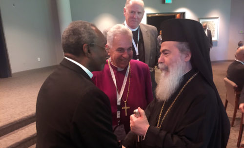 Archbishop Suheil Dawani of the Episcopal Diocese of Jerusalem (center) introduces Episcopal Church Presiding Bishop Michael Curry (left) to His Beatitude Theophilus III, Patriarch of Jerusalem and All Palestine (right) as the Rev. Robert Edmunds, the Episcopal Church's Middle East partnership officer, looks on.