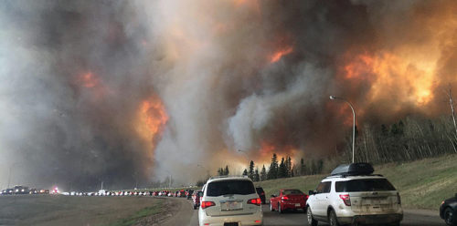 Flames and heavy smoke surrounded congested Highway 63 South outside of Fort McMurray, Alberta. Photo: DarrenRD via Wikimedia