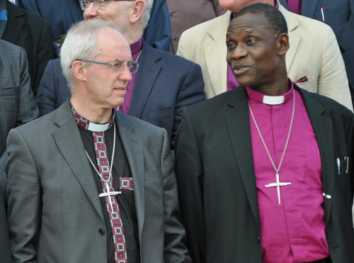 Archbishop of Canterbury Justin Welby, left, and Bishop Josiah Idowu-Fearon, Anglican Communion secretary general, have each said the Anglican Consultative Council endorsed certain consequences imposed on the Episcopal Church by the Communion's 38 primates. Their interpretation has been rejected by some ACC members. Photo: Mary Frances Schjonberg/Episcopal News Service