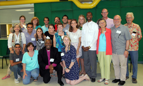 Long-term missionaries and Young Adult Service Corps missionaries posed with Presiding Bishop Michael Curry following a meeting held during the 21st annual Global Episcopal Mission Network Conference May 18-20 in Ponce, Puerto Rico. Photo: Lynette Wilson/Episcopal News Service