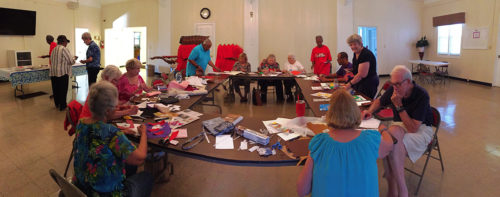 The Gatherers Around the Table work on their journal quilt projects at a recent gathering at Calvary Episcopal Church in Charleston, South Carolina. Photo: Don West.