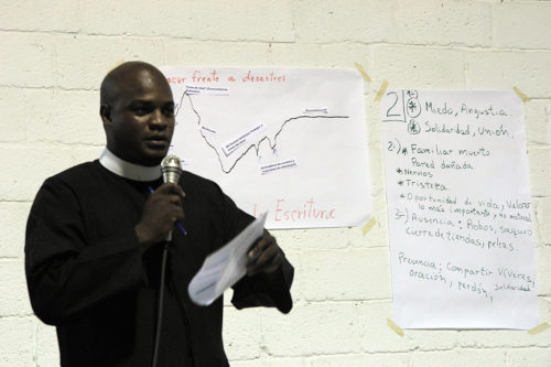 The Rev. Jairo Chiran Guillén, a deacon and the vicar serving St. James the Apostle in La Pila, speaks during the June 11 disaster response workshop held at St. Joseph the Worker. Photo: Lynette Wilson/Episcopal News Service
