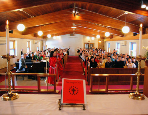 Holy Apostles Episcopal Church is home to a diverse congregation that includes a strong Hmong faith community; its sanctuary is pictured here on a typical Sunday during a Hmong service.  Photo: Holy Apostles