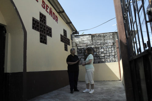 The Rev. Mariana Loor, vicar of Jesus the Lord Episcopal Church in Guayaquil, Ecuador, and Sarerna Pettit, of St. Joseph of Arimathea Episcopal Church in Hendersonville, Tennessee, talk outside the church. Photo: Lynette Wilson/Episcopal News Service