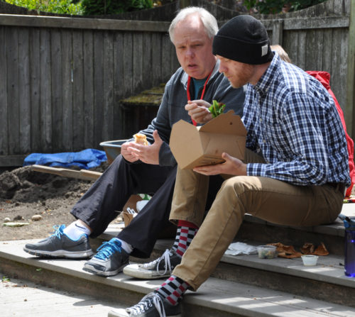 The Rev. Joshua Kingsley, Diocese of Oregon, right, and Greg Rhodes, Diocese of Olympia, share lunch in the urban garden at St. Mark's Cathedral in Seattle during the June Called to Transformation Asset-Based Community Development (ABCD) facilitator formation workshop. Photo: Mary Frances Schjonberg/Episcopal News Service