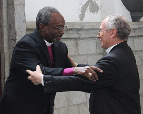 Presiding Bishop Michael Curry and Monsignor Luís Cabrera Herrera, OFM, the Roman Catholic archbishop of Guayaquil, greet each other June 29 during Curry's visit to the Episcopal Diocese of Ecuador Litoral. Photo: Edgar Giraldo
