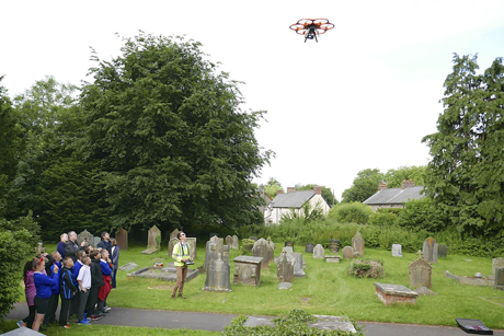 Pupils from St Nicholas Church in Wales Primary School watching the drone being flown. Photo: Diocese of Llandaff